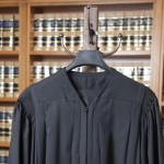 Hand and judicial robe photo illustration  Photo by Jason Doiy and S. Todd Rogers 8-29-13 062-2013
